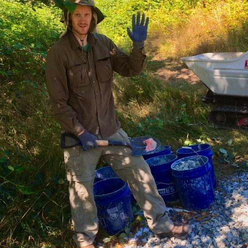 Bret loads rock in buckets...